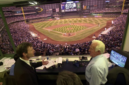 Governor Scott McCallum, left, and Brewers broadcaster Bob Uecker chat in the booth at Miller Park during the first game in the stadium's history: April 6, 2001.
