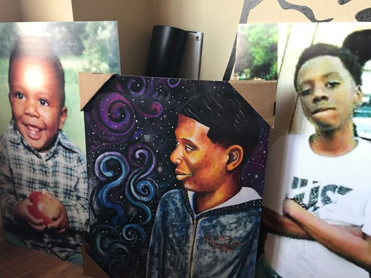 Dombanee Lincoln keeps tribute photos to her son Dennis King, including his baby photo, and a painting, in her living room.