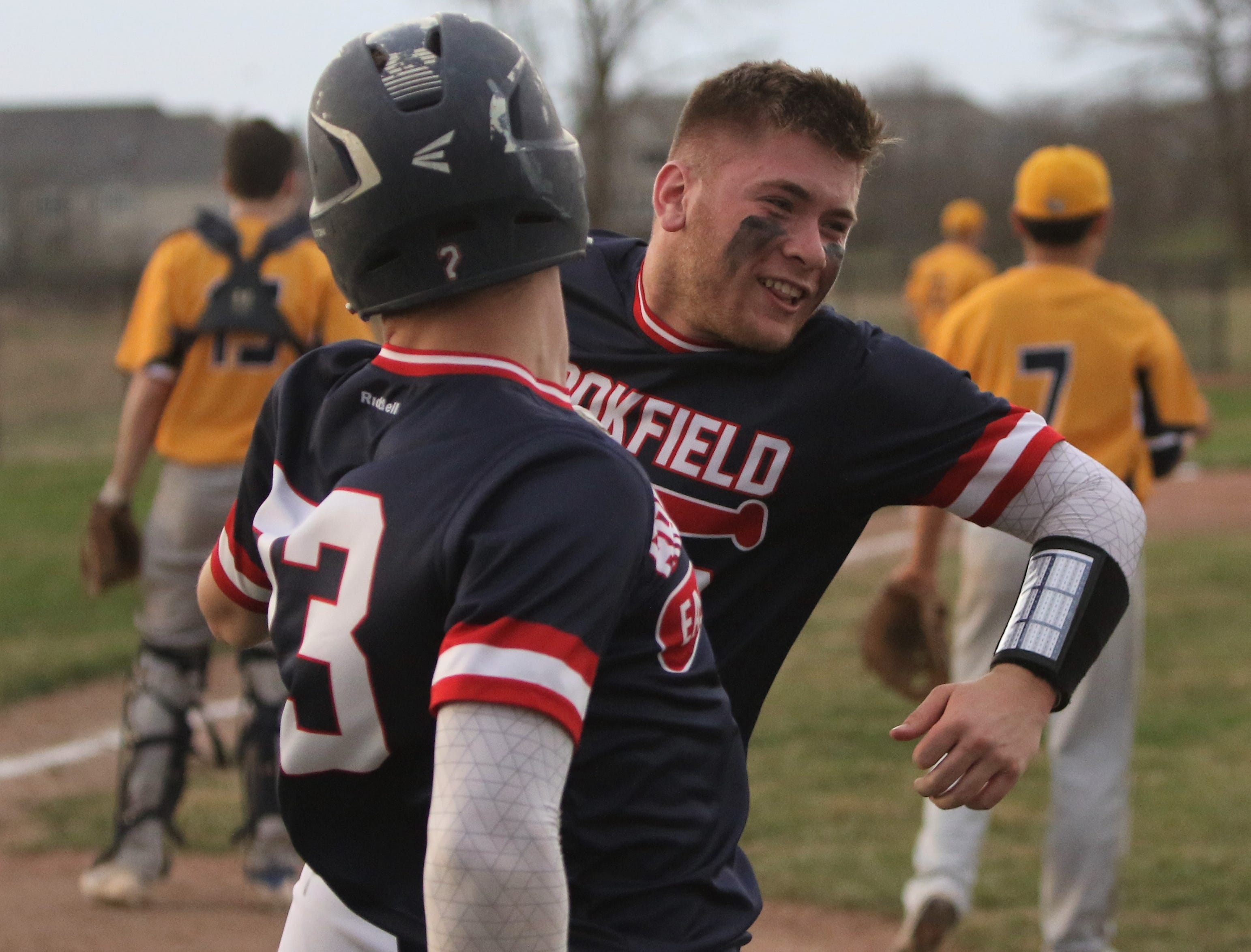 Brookfield East teammates Ryan Mazza (right) and Jack Steger celebrate during their team's six-run sixth inning to take the lead over Brookfield Academy.