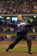 President George W. Bush throws the ceremonial first pitch at Miller Park. Bush's presidency began earlier in 2001 and he became the first president to throw a first pitch at a baseball game in the state of Wisconsin.