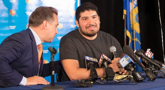 Manuel Franco, right, who purchased the $768.4 million Powerball ticket sold last month in New Berlin, listens to his attorney, Andrew Stoltmann, at a news conference Tuesday at the Wisconsin Lottery's offices in Madison.