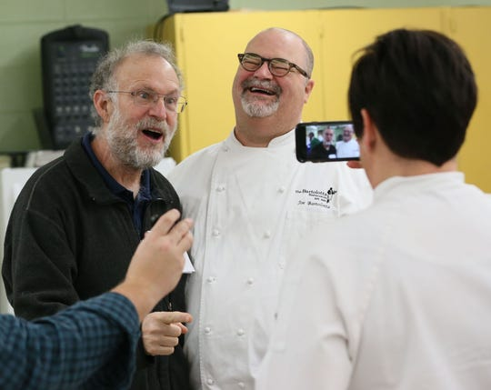Joe Bartolotta (center) laughs with  Jerry Greenfield of Ben & Jerry's Ice Cream fame as Bartolotta's wife, Jennifer, records a video of the two in 2017.  They were judging the ice cream making contest at James Madison Academic Campus in Milwaukee.
