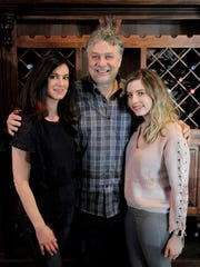 Spiro Asimakopoulos, center, runs Crave Bar and Food with his fiancee Angela Pagoulatos and his daughter  Vicki Asimakopoulos. They are opening a new Greek restaurant, Santorini Grill, in the Mequon Public Market, in June.