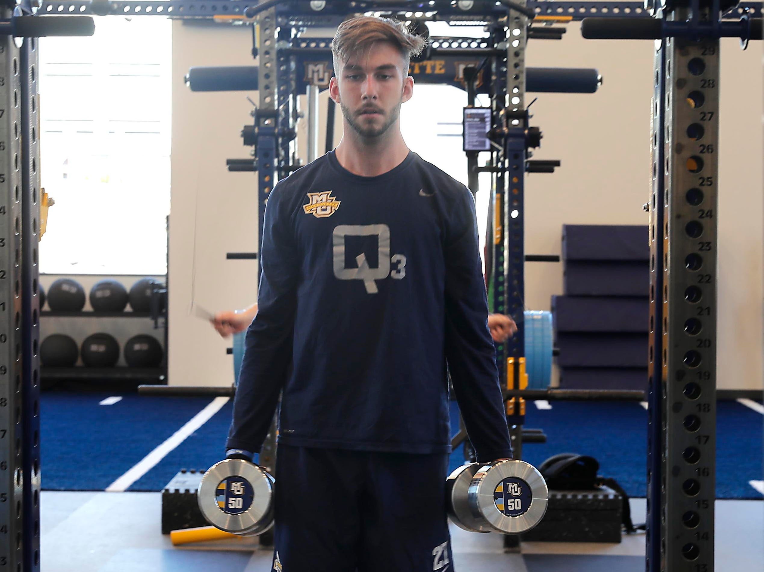 A student works out in the strength and conditioning area.
