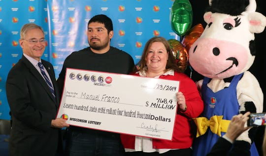 Manuel Franco, 24, second from left, of West Allis was the winner of the $768.4 million Powerball jackpot. He took the lump sum payout of $477 million. With him are Wisconsin Department of Revenue Secretary Peter Barca and Wisconsin Lottery Director Cindy Polzin.