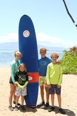 Madelyn Wood, Jude, Thomas and Tanner Nichols are shown before their first day of surfing lessons in Maui.