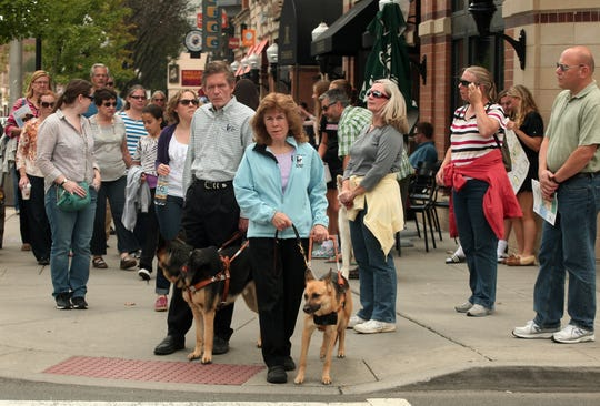 James Kutsch, Jr. President and CEO of The Seeing Eye and wife Ginger lead a tour during a Guide Dog Training Program where visitors learn the history of The Seeing Eye, walk the streets where the dogs train and see how the Seeing Eye dogs respond to their owners, September 20, 2014, Morristown, NJ. Photo by Bob Karp