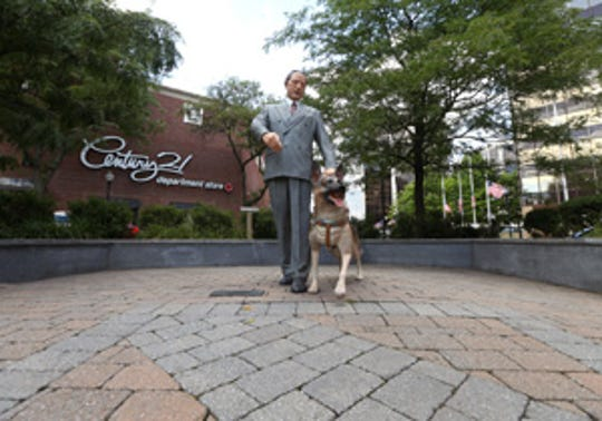 Statue off the Morristown Green of statue of Seeing Eye organization founder Morris Frank and his dog, Buddy. Placester photos of downtown Morristown. July 11, 2016, Morristown, NJ