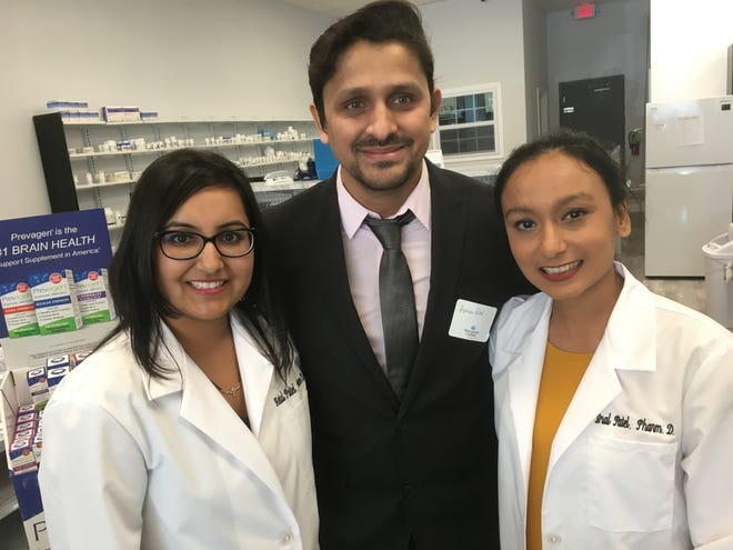 From left, pharmacists Hetal, Ashish and Iral Patel have opened iKare Pharmacy in the Peppertree Plaza shopping center.