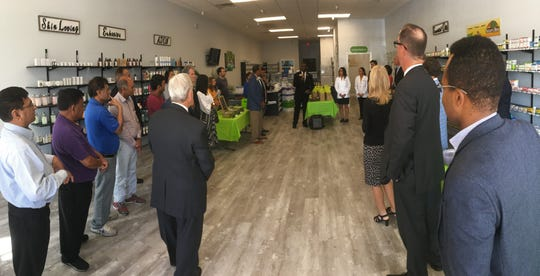 City official speak during a ribbon-cutting ceremony for iKare Pharmacy in east Montgomery.