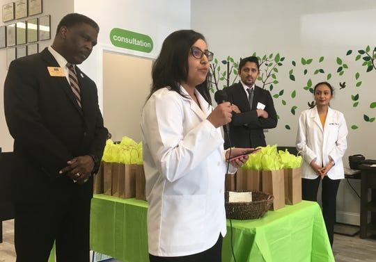 Pharmacist Hetal Patel speaks during a ribbon-cutting ceremony for iKare Pharmacy.