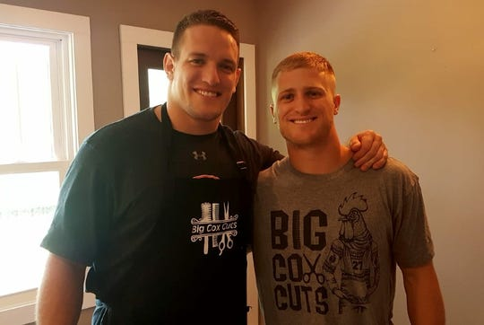 Chandler Cox (left) poses for a photo with Griffin King (right) after cutting his hair on April 17, 2019, in Auburn, Ala.