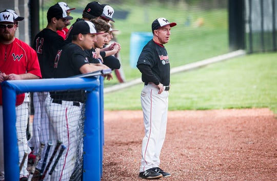 Wapahani's Brian Dudley coaches against Delta during their game at Delta High School Tuesday, April 23, 2019.