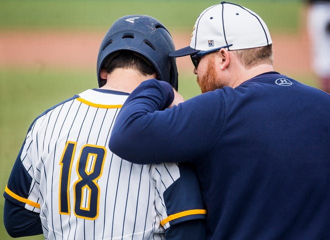 FILE -- Delta coach Seth Paul gives instructions to Anthony Gullion against Wapahani during their game at Delta High School Tuesday, April 23, 2019. On Thursday, April 2, 2020, the IHSAA announced the 2020 spring sports season has been canceled.