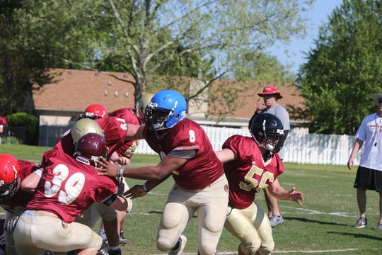 Riverdale defensive end Javon Nelson (8) works on drills during Monday's spring practice.
