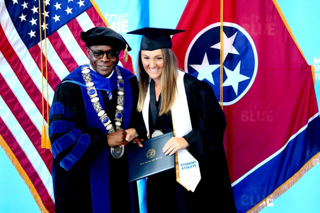 MTSU President Sidney McPhee poses for a photo with Hanley Long during a special graduation ceremony in May 2019 for athletes who were unable to attend the traditional commencement exercises due to conflicts with post-season tournaments. The university will hold a virtual graduation ceremony for the May 2020 graduates.