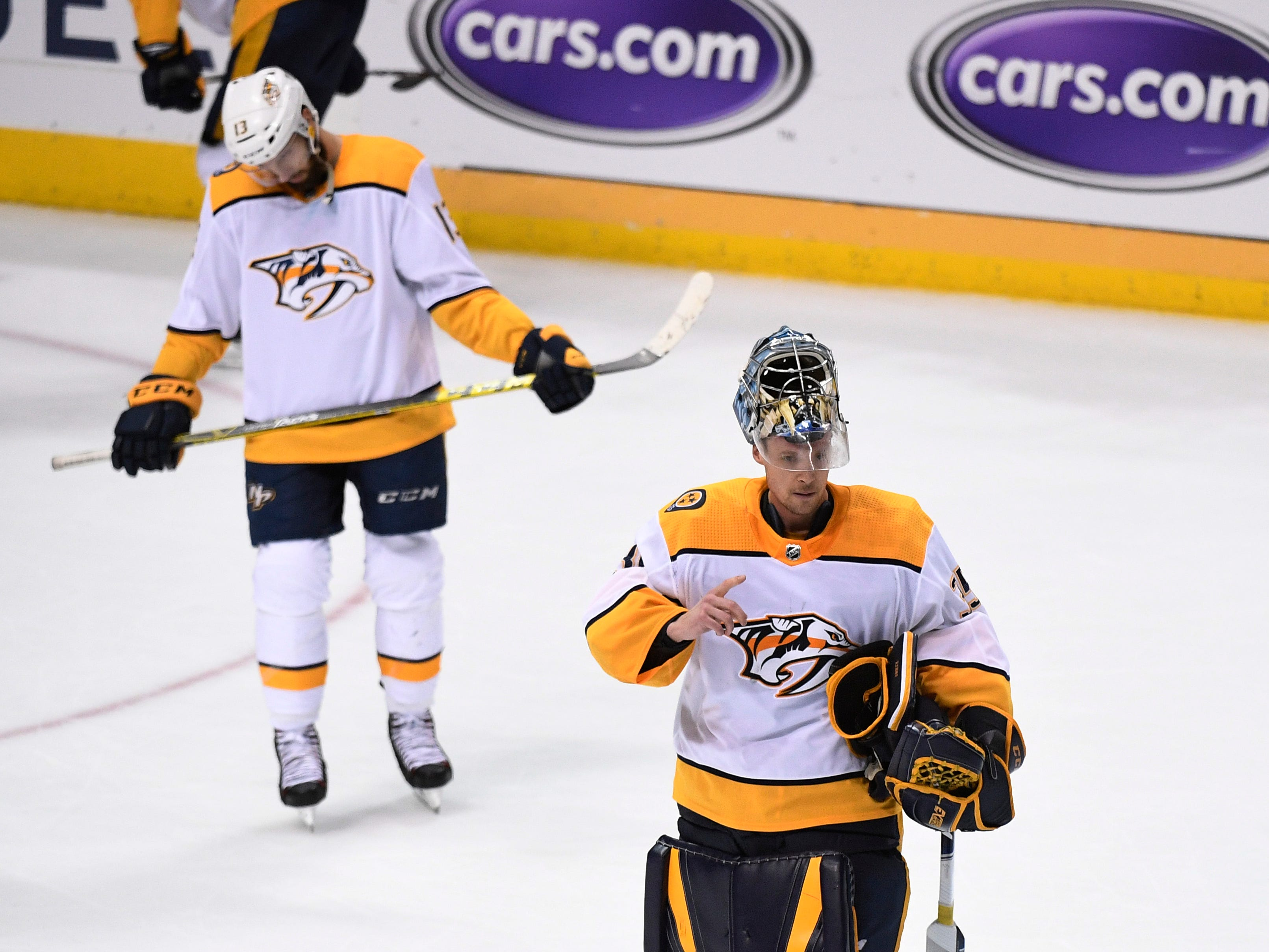 Nashville Predators center Nick Bonino (13) and goaltender Pekka Rinne (35) react to the team's overtime loss to the Dallas Stars in their divisional semifinal game at the American Airlines Center in Dallas, Texas, Monday, April 22, 2019.