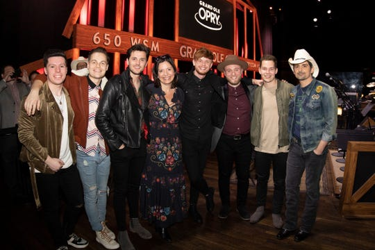 King Calaway poses with Sally Williams, senior vice president of programming and artist relations/general manager of the Grand Ole Opry, and country star Brad Paisley. King Calaway is, from left: Caleb Miller, Chris Deaton, Simon Dumas, Jordan Harvey, Chad Michael Jervis and Austin Luther.