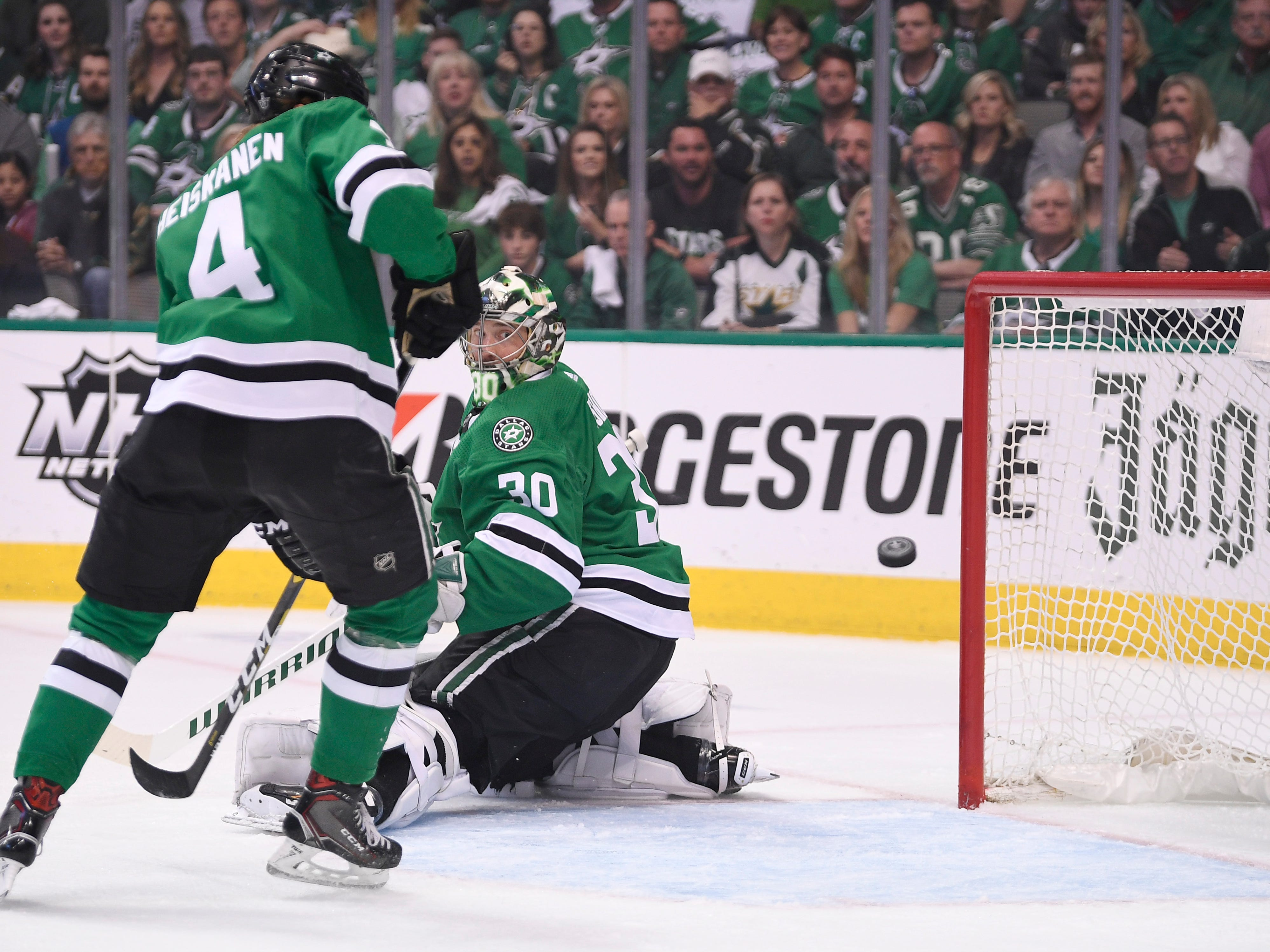 Dallas Stars goaltender Ben Bishop (30) keeps his eye on a Nashville Predators shot next to defenseman Miro Heiskanen (4) during the first  period of the divisional semifinal game at the American Airlines Center in Dallas, Texas, Monday, April 22, 2019.