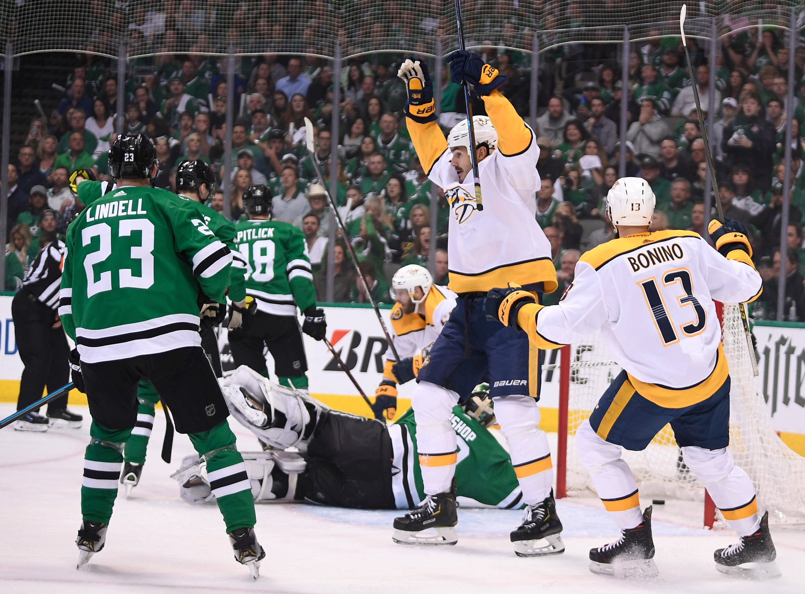 Nashville Predators center Brian Boyle (11) celebrates the goal by left wing Austin Watson (51) during the first period of the divisional semifinal game at the American Airlines Center in Dallas, Texas, Monday, April 22, 2019.