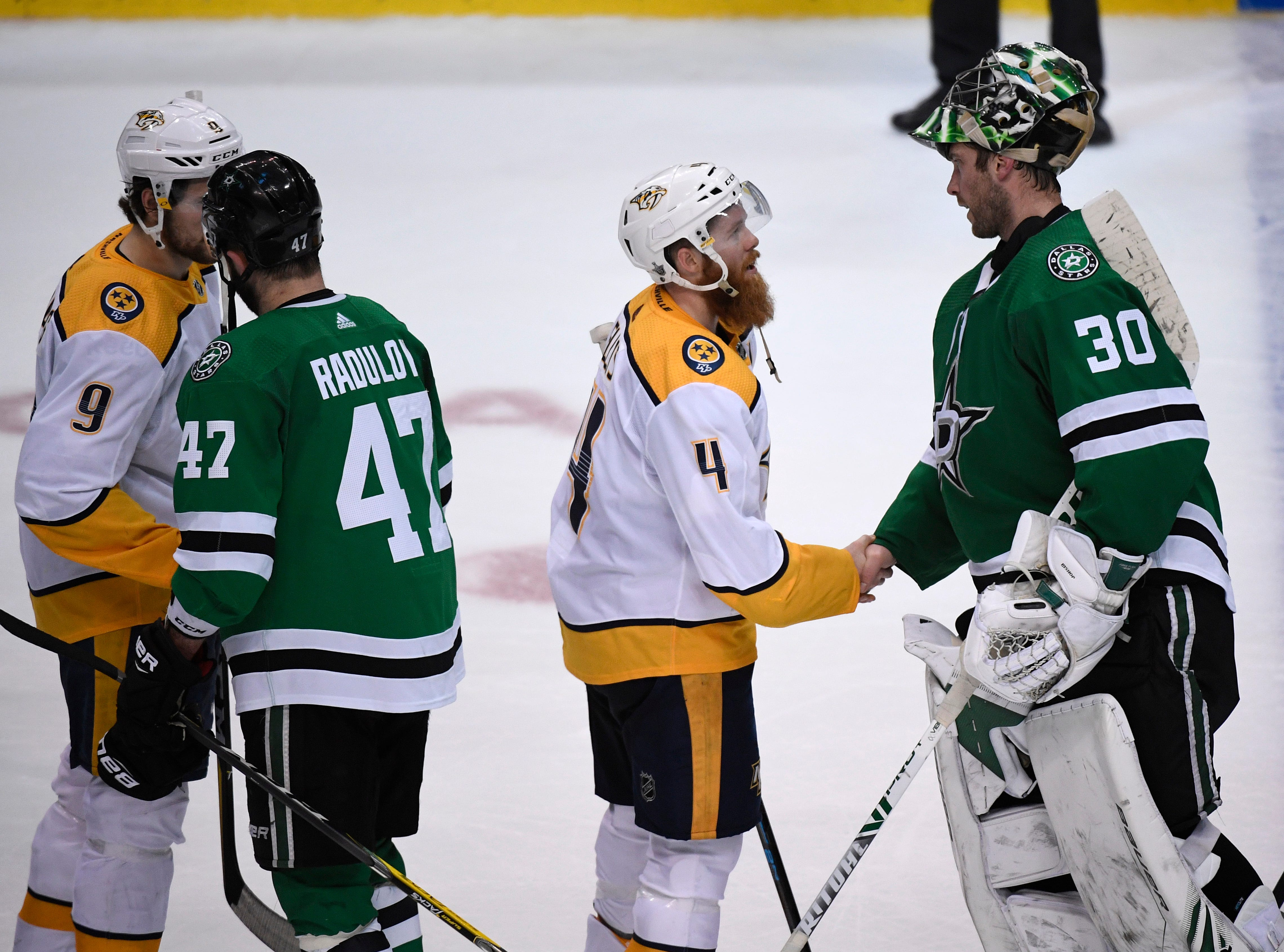 Nashville Predators left wing Filip Forsberg (9) and defenseman Ryan Ellis (4) shake hands with Dallas Stars right wing Alexander Radulov (47) and goaltender Ben Bishop (30) after losing the divisional semifinal series at the American Airlines Center in Dallas, Texas, Monday, April 22, 2019.