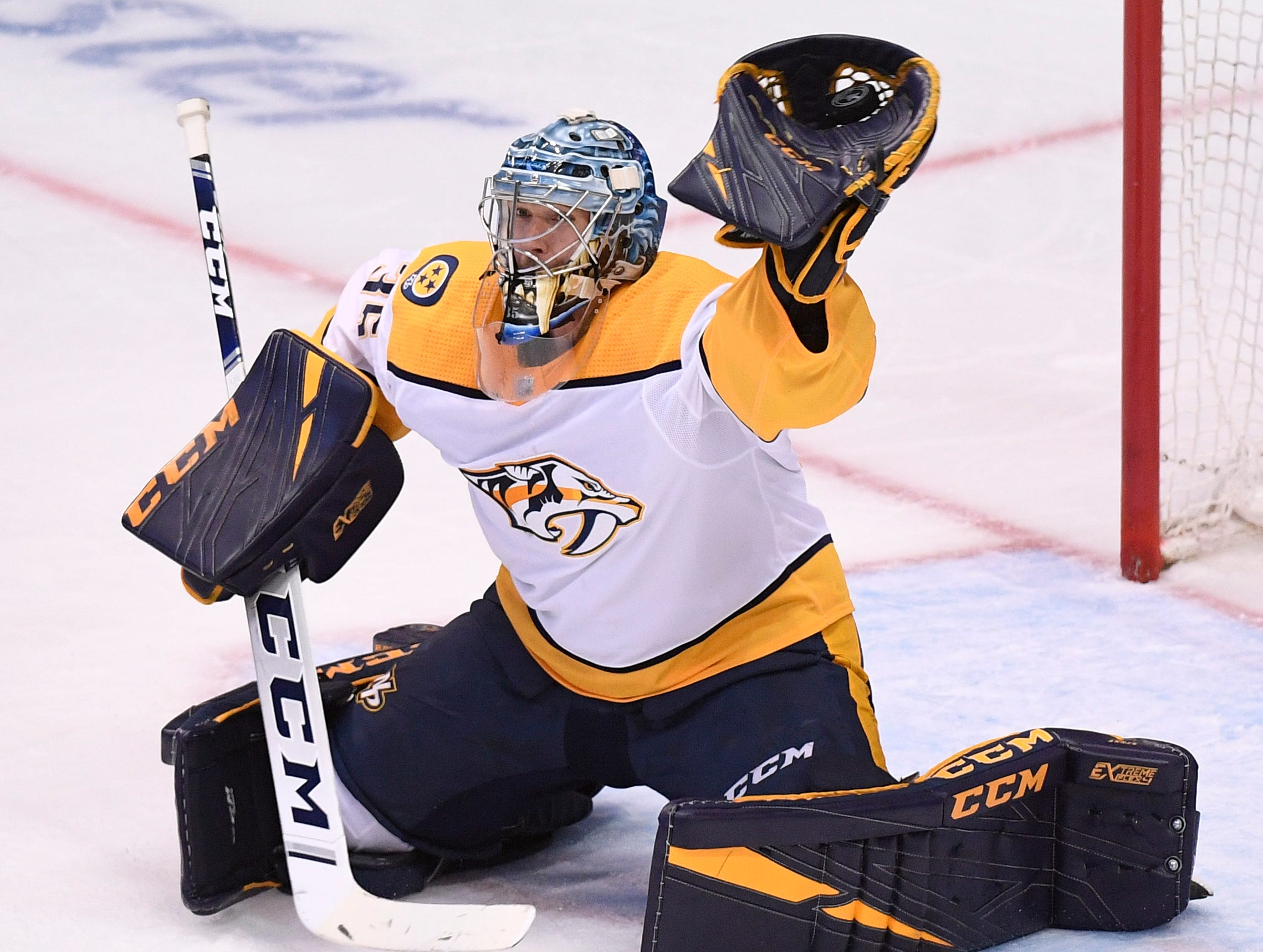Nashville Predators goaltender Pekka Rinne (35) makes a save against the Dallas Stars during the second period of the divisional semifinal game at the American Airlines Center in Dallas, Texas, Monday, April 22, 2019.
