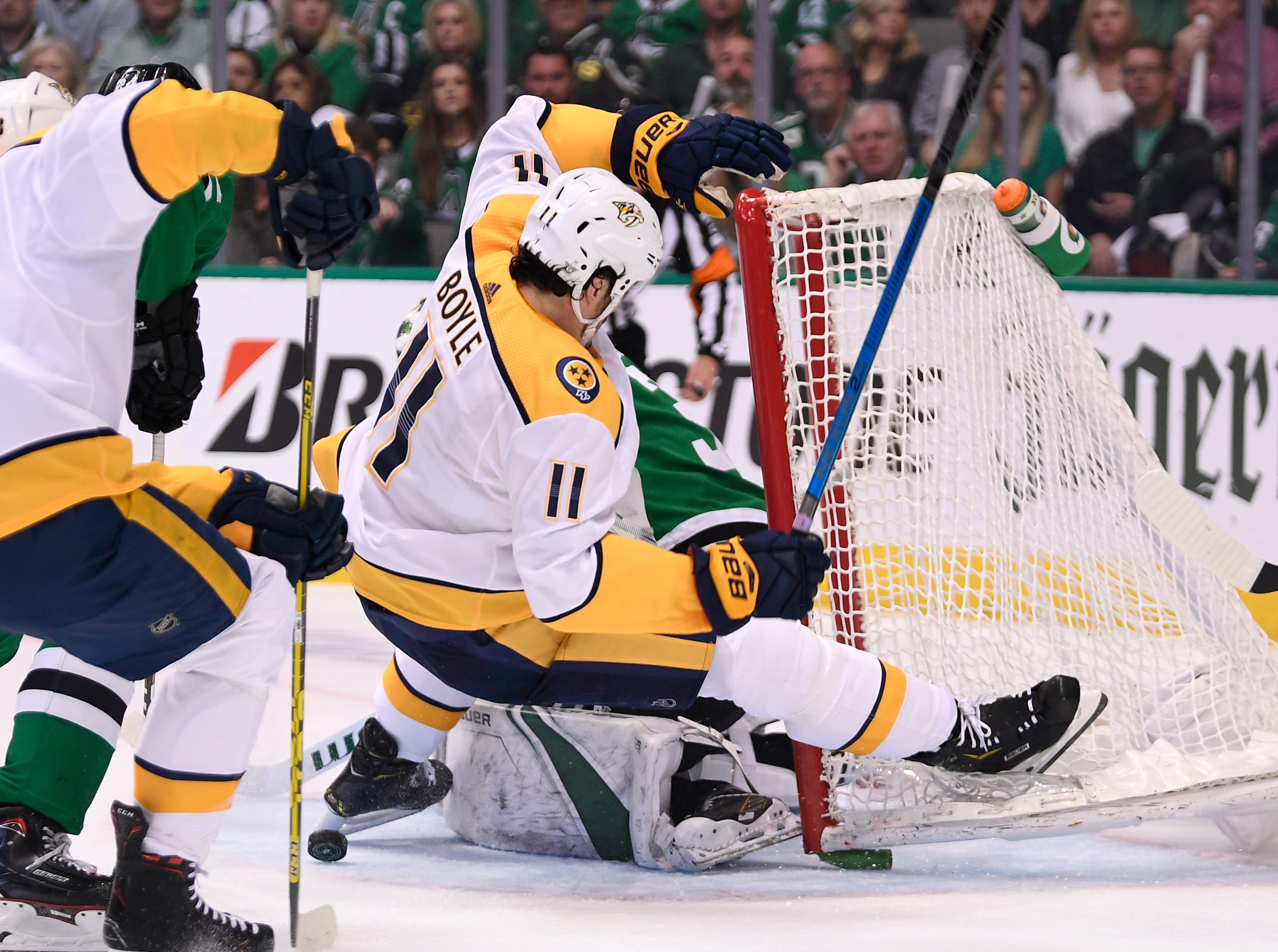 Nashville Predators center Brian Boyle (11) hits the ice after a shot at Dallas Stars goaltender Ben Bishop (30) during the first period of the divisional semifinal game at the American Airlines Center in Dallas, Texas, Monday, April 22, 2019.