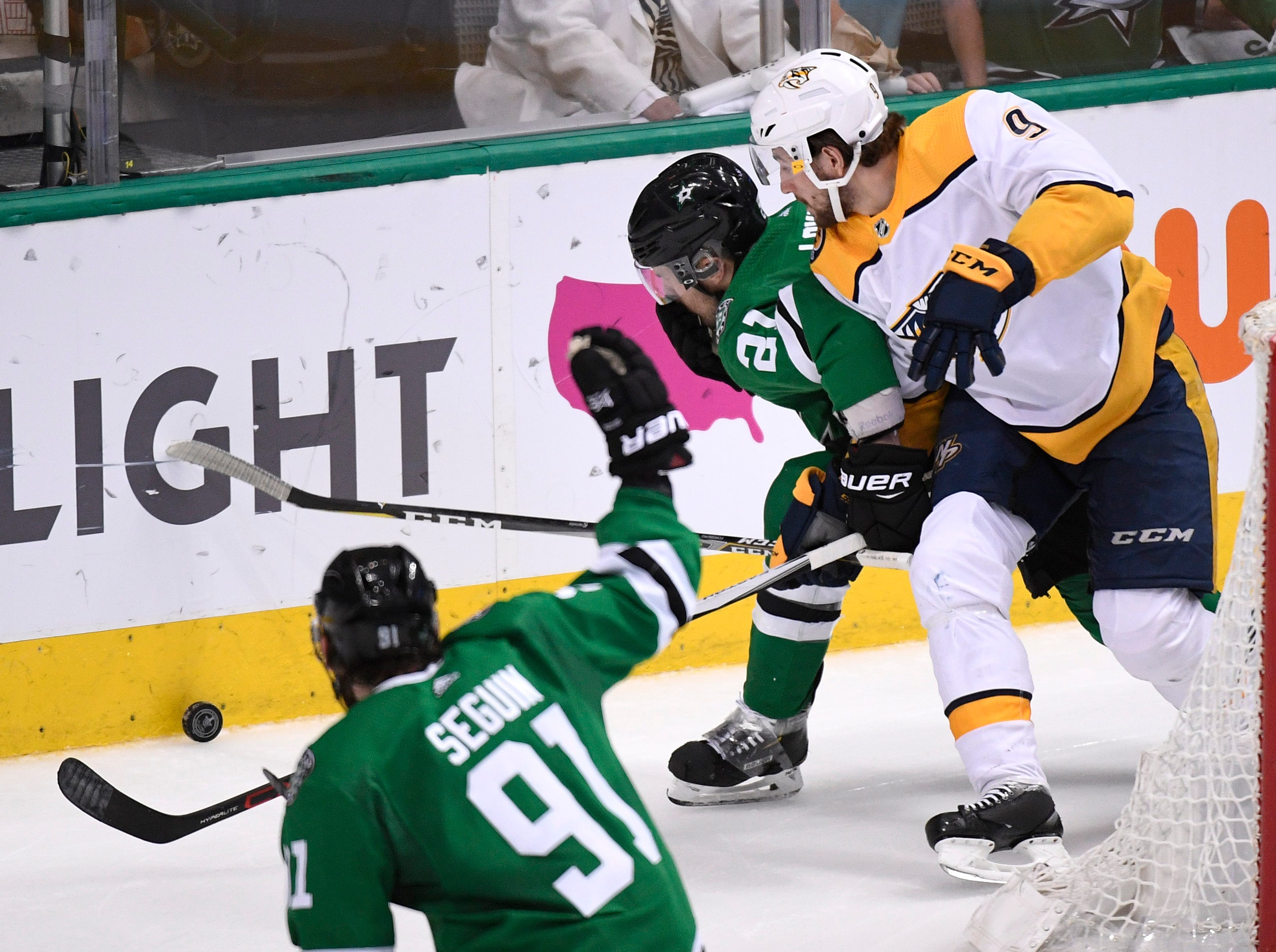 Nashville Predators left wing Filip Forsberg (9) battles for the puck with Dallas Stars defenseman Ben Lovejoy (21) during the second period of the divisional semifinal game at the American Airlines Center in Dallas, Texas, Monday, April 22, 2019.