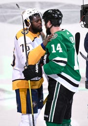 Nashville Predators defenseman P.K. Subban (76) and Dallas Stars left wing Jamie Benn (14) chat after Dallas won the  divisional semifinal series at the American Airlines Center in Dallas, Texas, Monday, April 22, 2019.