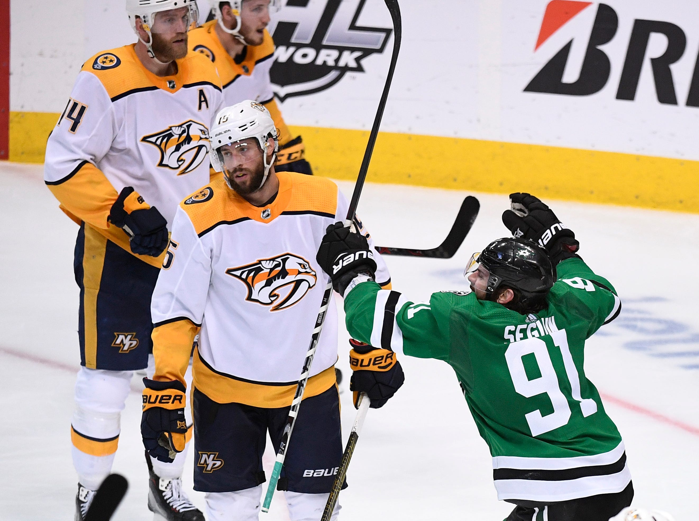 Dallas Stars center Tyler Seguin (91) reacts to the game-winning overtime goal by defenseman John Klingberg (3) as Nashville Predators right wing Craig Smith (15) looks away in the divisional semifinal game at the American Airlines Center in Dallas, Texas, Monday, April 22, 2019.