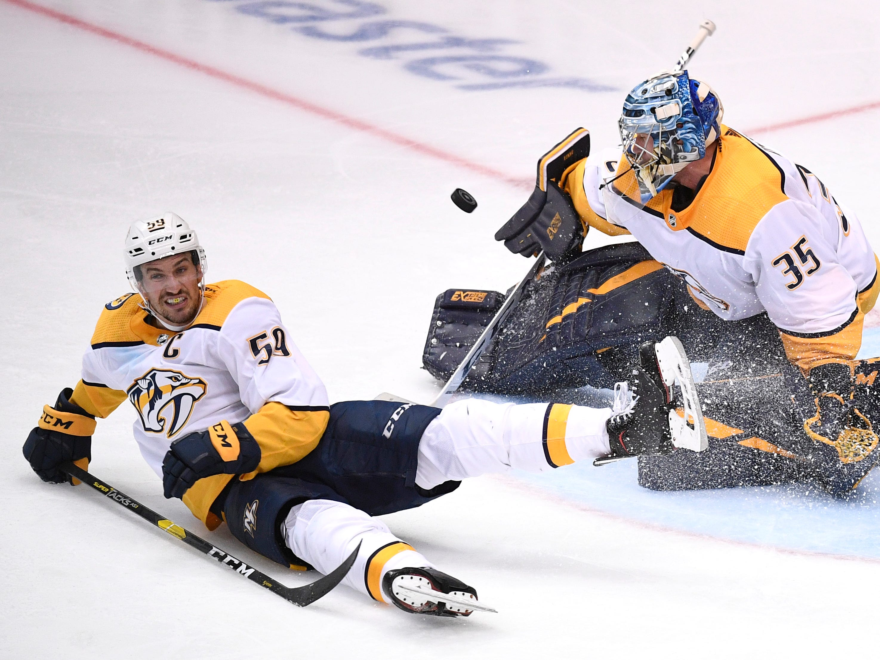 Nashville Predators defenseman Roman Josi (59) goes down in front of Nashville Predators goaltender Pekka Rinne (35) defending the net against a Dallas Stars shot during overtime of the divisional semifinal game at the American Airlines Center in Dallas, Texas, Monday, April 22, 2019.