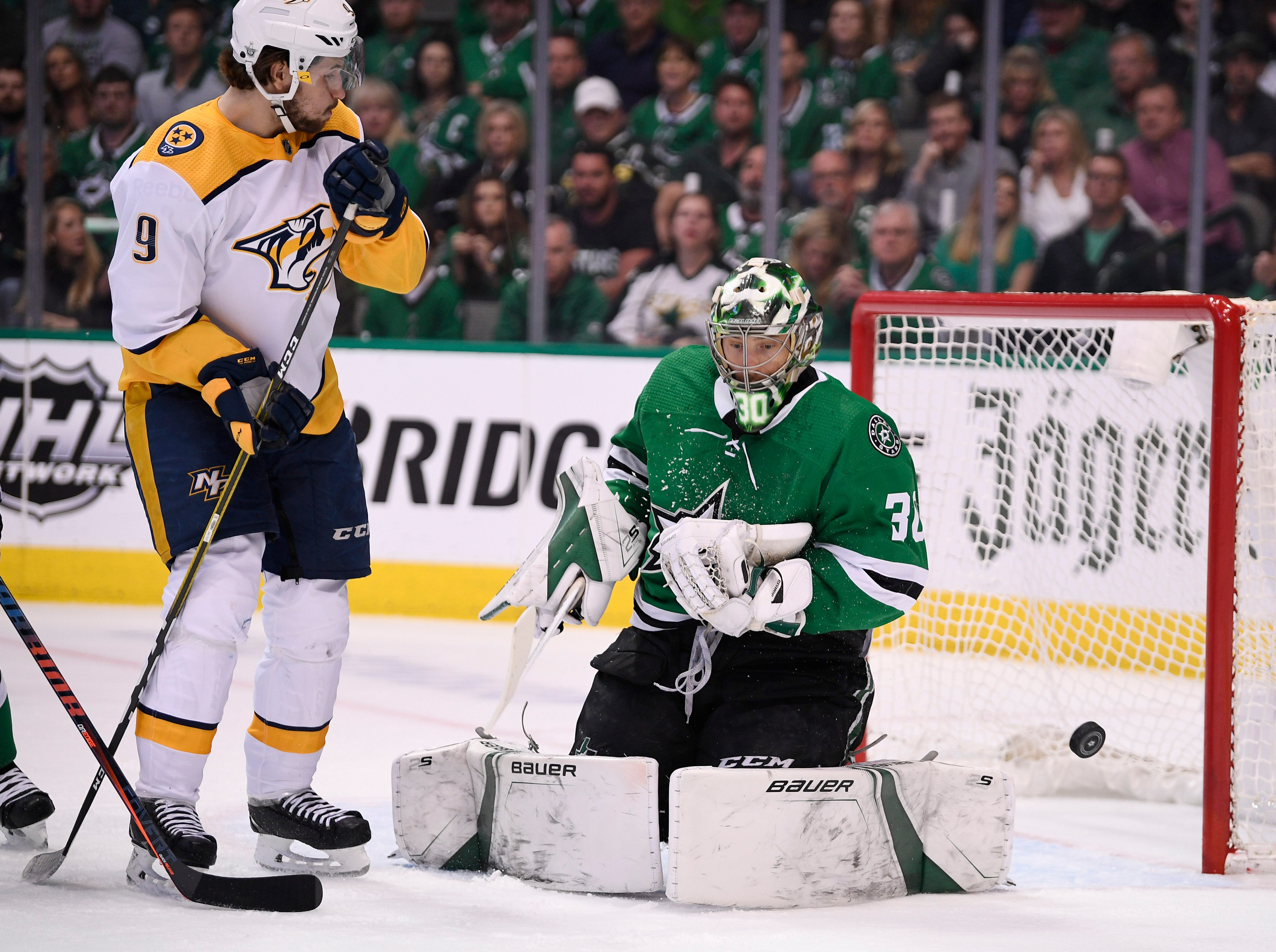 Dallas Stars goaltender Ben Bishop (30) defends against Nashville Predators left wing Filip Forsberg (9) during the first period of the divisional semifinal game at the American Airlines Center in Dallas, Texas, Monday, April 22, 2019.