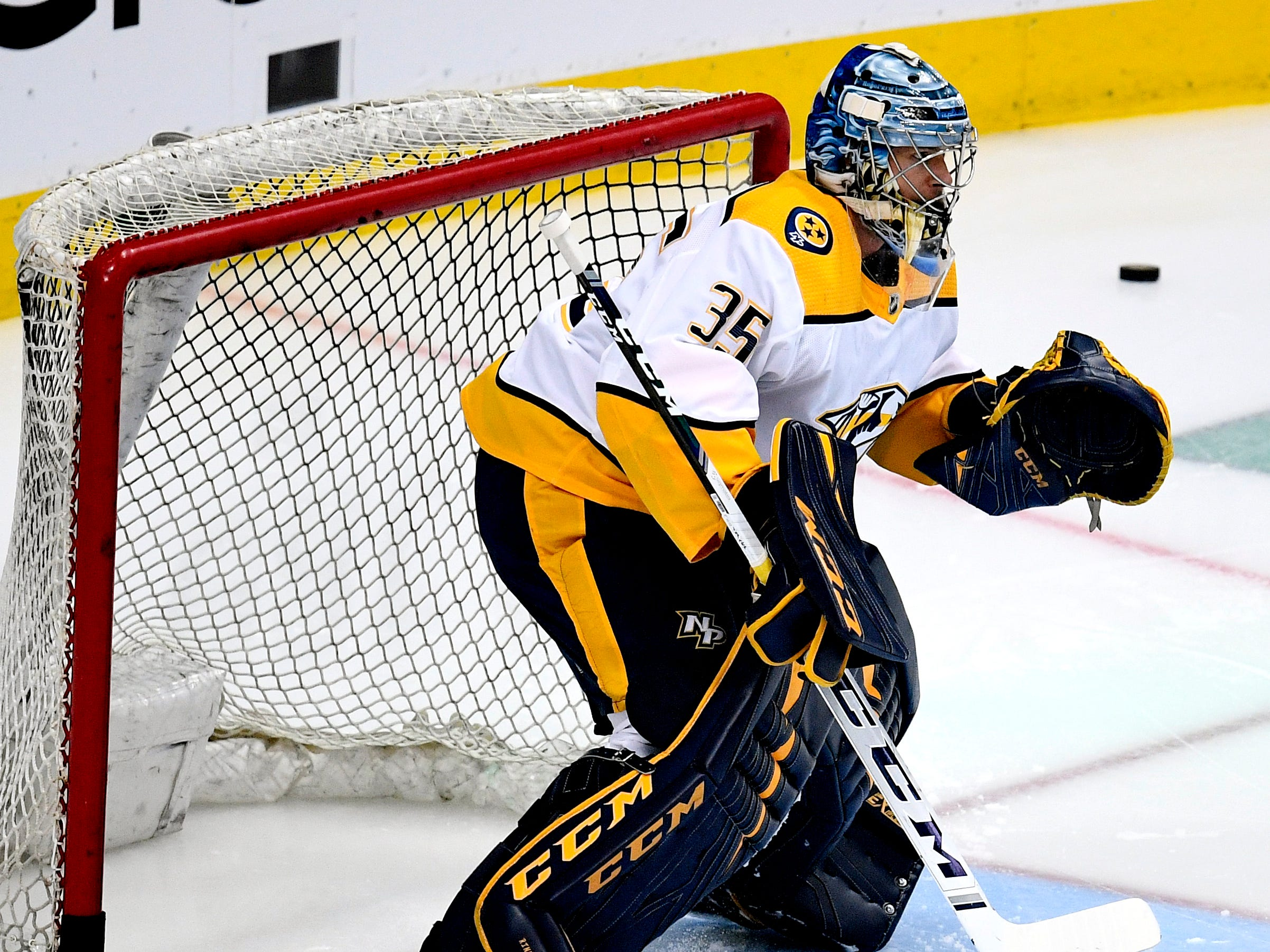 Nashville Predators goaltender Pekka Rinne (35) warms up before the divisional semifinal game against the Dallas Stars at the American Airlines Center in Dallas, Texas, Monday, April 22, 2019.
