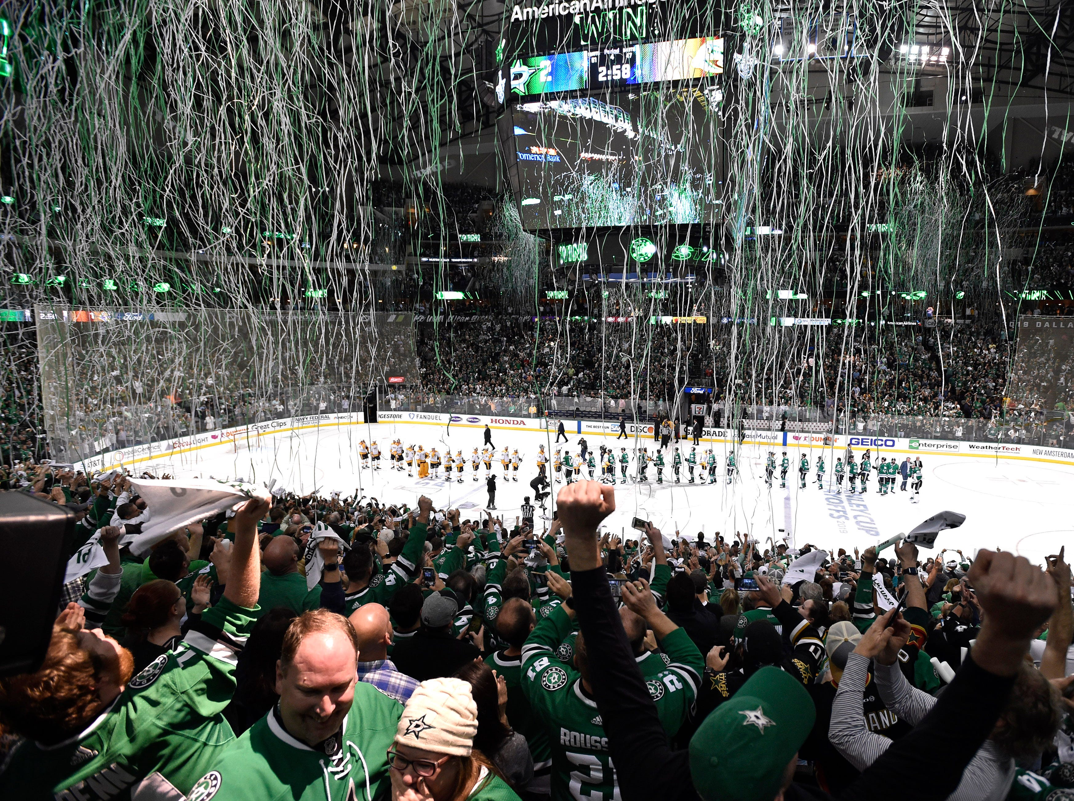 Dallas Stars fans celebrate the team's overtime win over the Nashville Predators, clinching the divisional semifinal series at the American Airlines Center in Dallas, Texas, Monday, April 22, 2019.