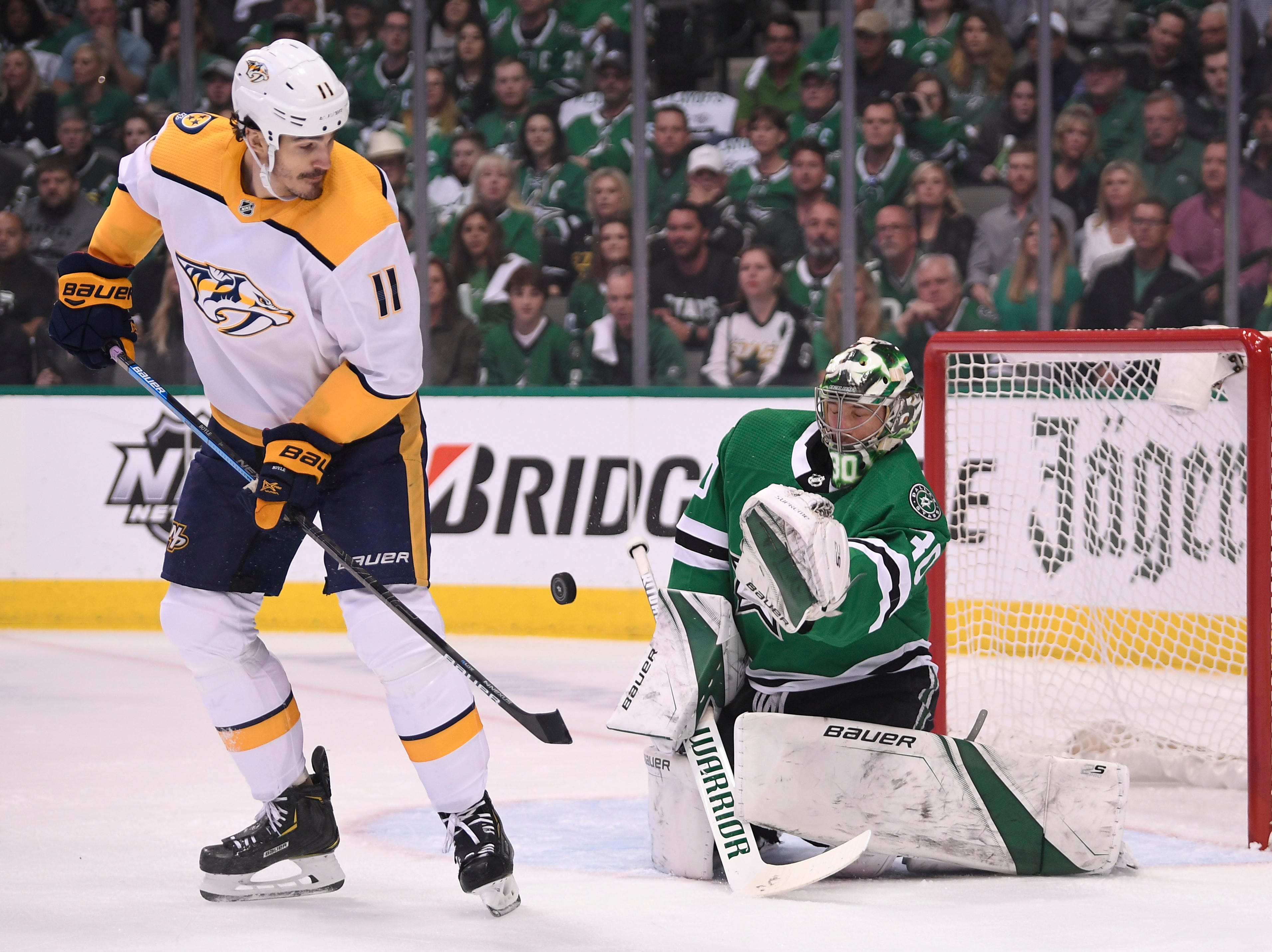 Dallas Stars goaltender Ben Bishop (30) defends against Nashville Predators center Brian Boyle (11) during the first period of the divisional semifinal game at the American Airlines Center in Dallas, Texas, Monday, April 22, 2019.