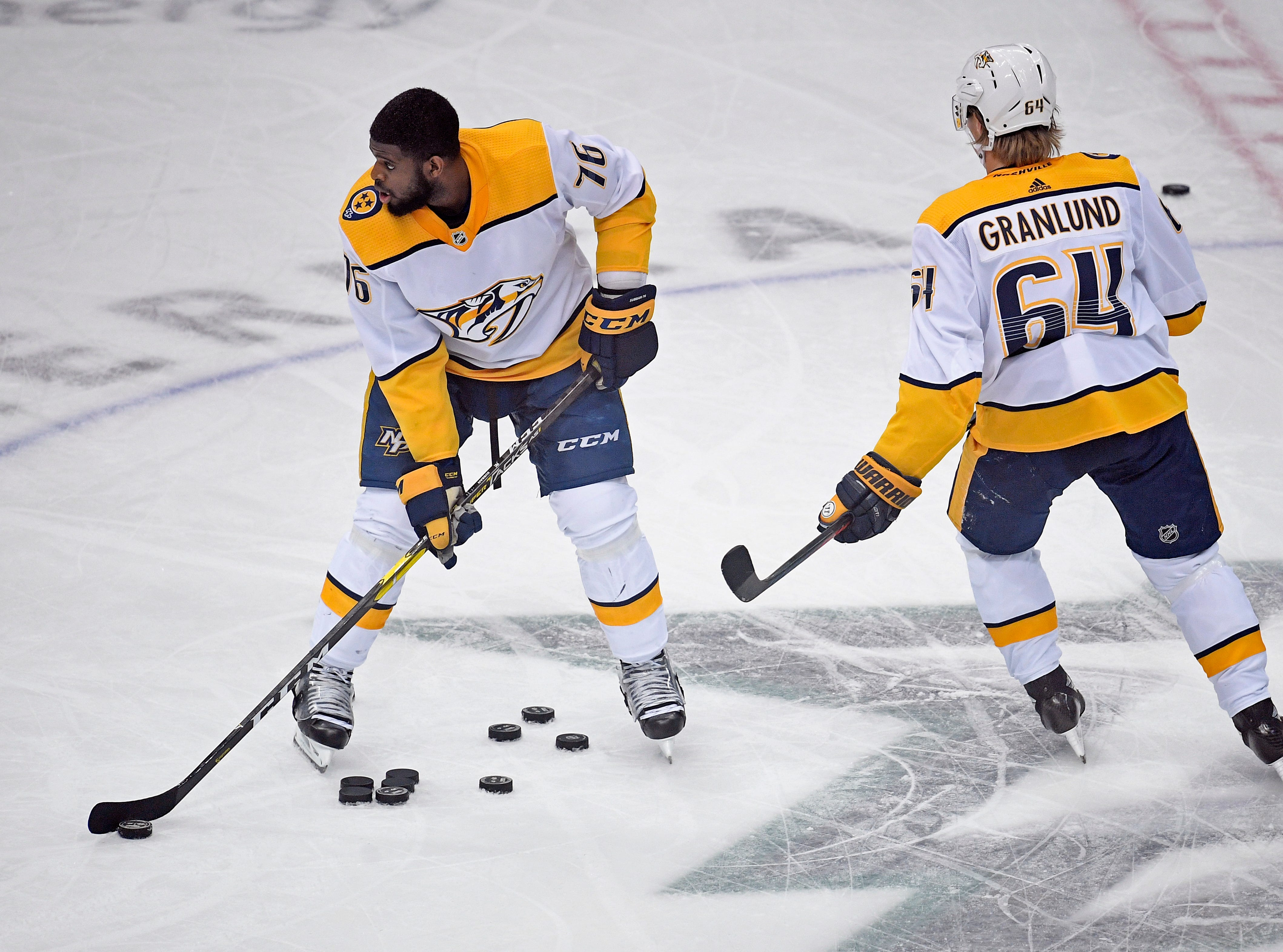 Nashville Predators defenseman P.K. Subban (76) and center Mikael Granlund (64) warm up before the divisional semifinal game against the Dallas Stars at the American Airlines Center in Dallas, Texas, Monday, April 22, 2019.