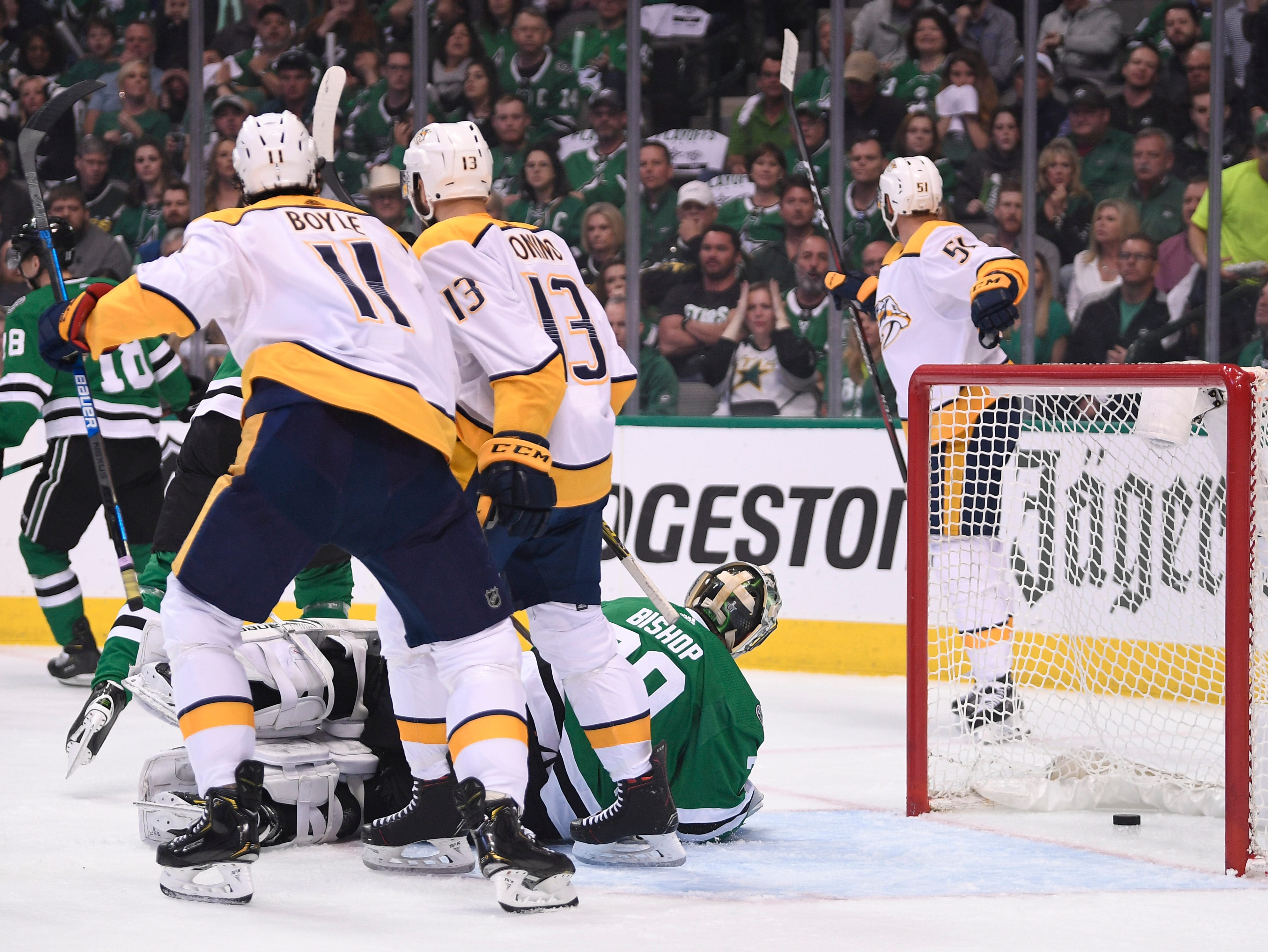 The Predators react to the goal by Nashville Predators left wing Austin Watson (51), back right, during the first period of the divisional semifinal game at the American Airlines Center in Dallas, Texas, Monday, April 22, 2019.