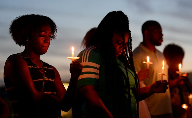 Dozens of family, friends and community residents attend a candlelight vigil for victims of the Waffle House shooting at the Southeast Community Center on Monday, April 22, 2019, in Nashville, Tenn. The event was held to commemorate the one-year anniversary of the mass shooting in Nashville.