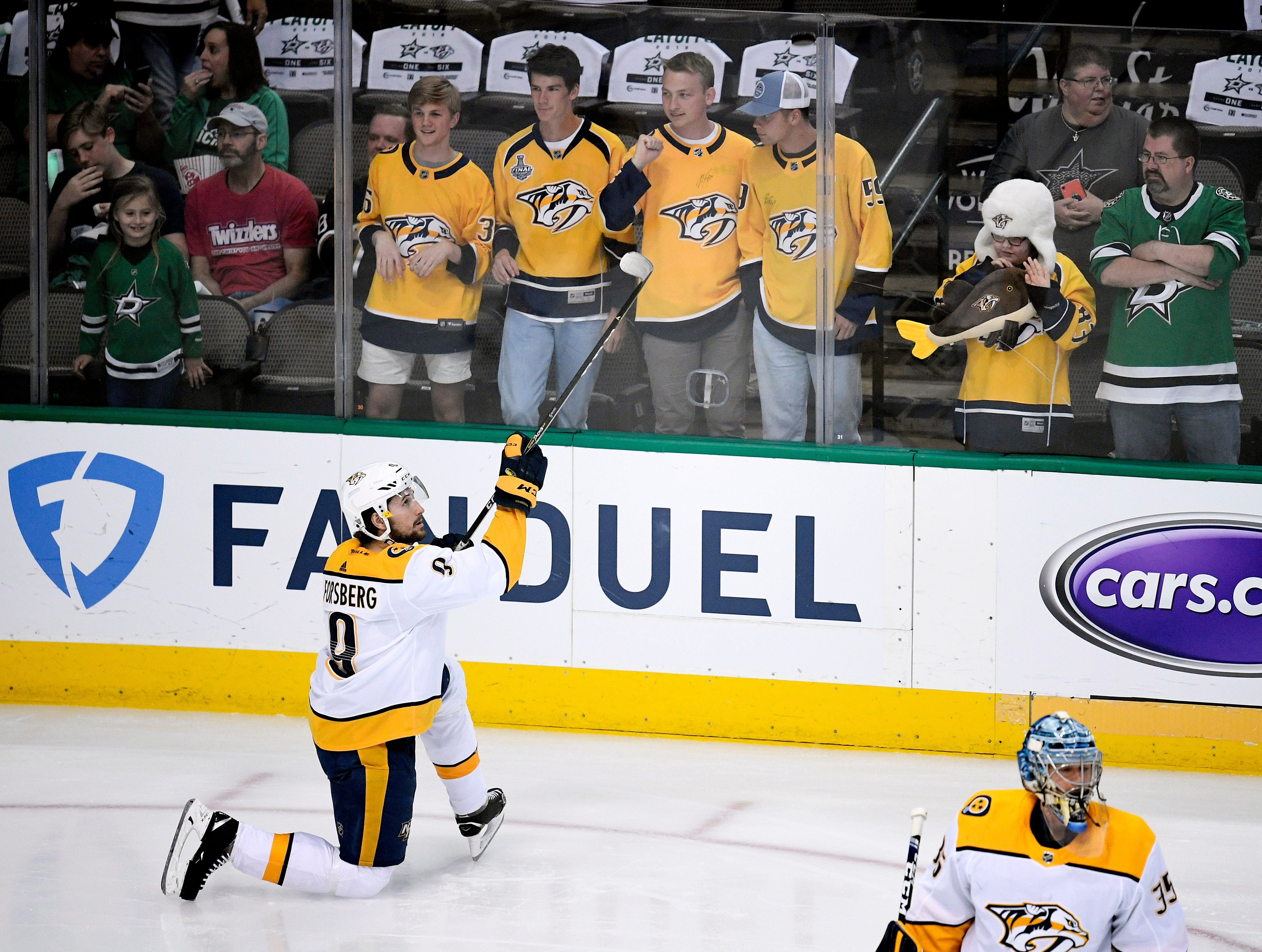 Predators fans watch Nashville Predators left wing Filip Forsberg (9) warm up before the divisional semifinal game against the Dallas Stars at the American Airlines Center in Dallas, Texas, Monday, April 22, 2019.