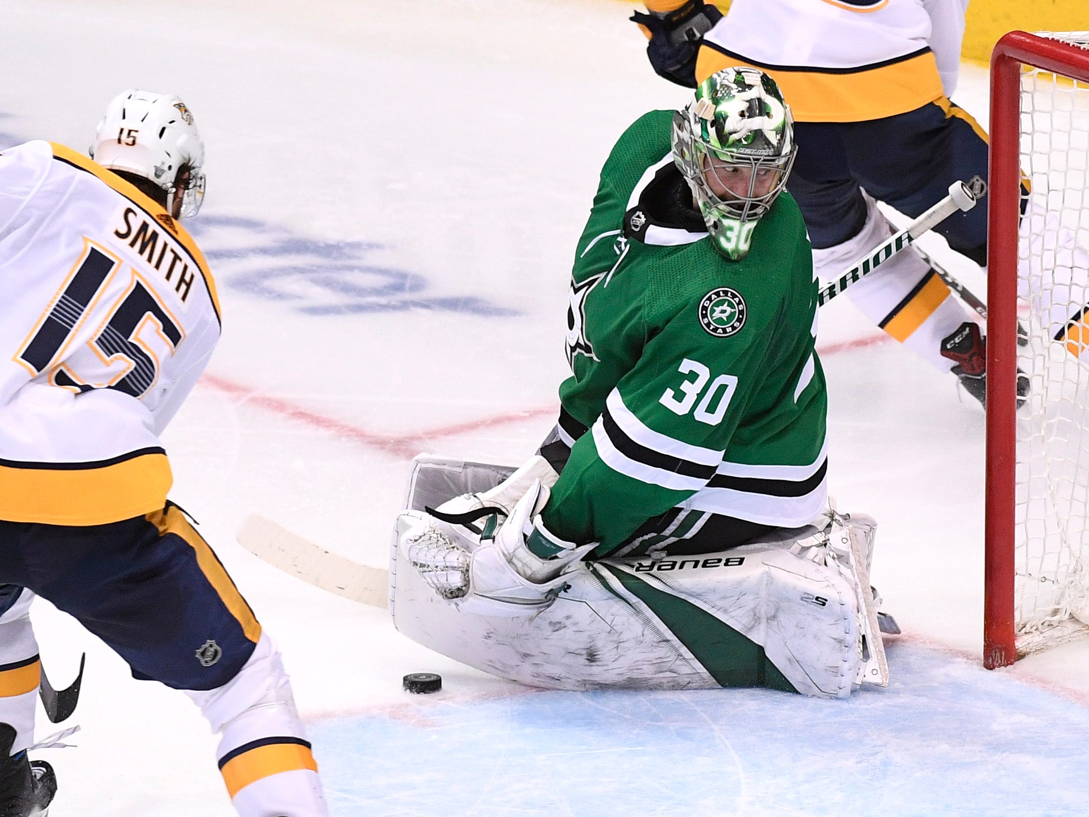 Dallas Stars goaltender Ben Bishop (30) defends the nets against Nashville Predators right wing Craig Smith (15) during the third period of the divisional semifinal game at the American Airlines Center in Dallas, Texas, Monday, April 22, 2019.