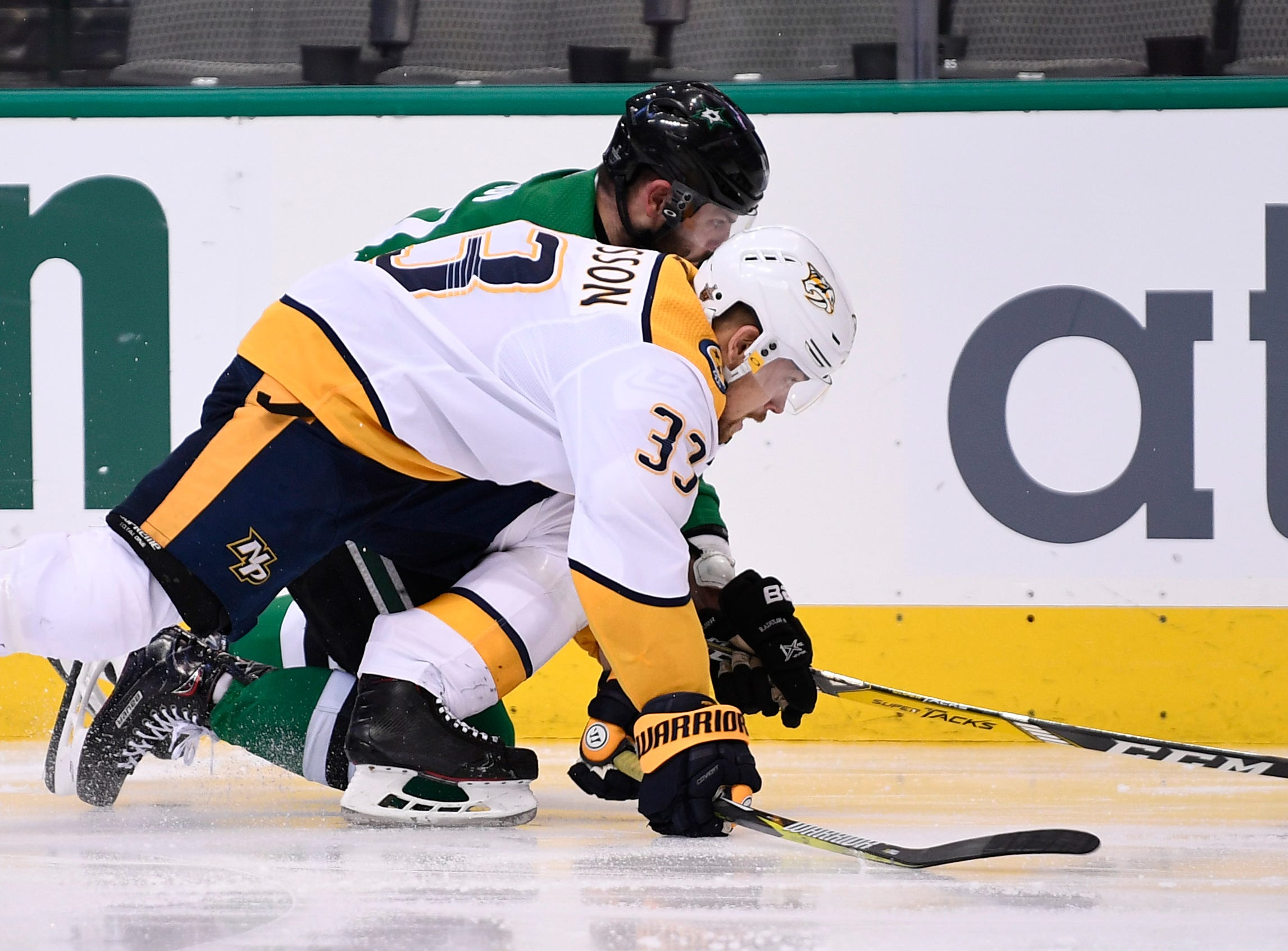 Nashville Predators right wing Viktor Arvidsson (33) and Dallas Stars right wing Alexander Radulov (47) battle for the puck during the second period of the divisional semifinal game at the American Airlines Center in Dallas, Texas, Monday, April 22, 2019.