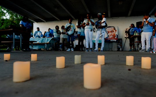 The family of Waffle House shooting victim Akilah DaSilva speak during a candlelight vigil at the Southeast Community Center on April 22, a year after the shooting.