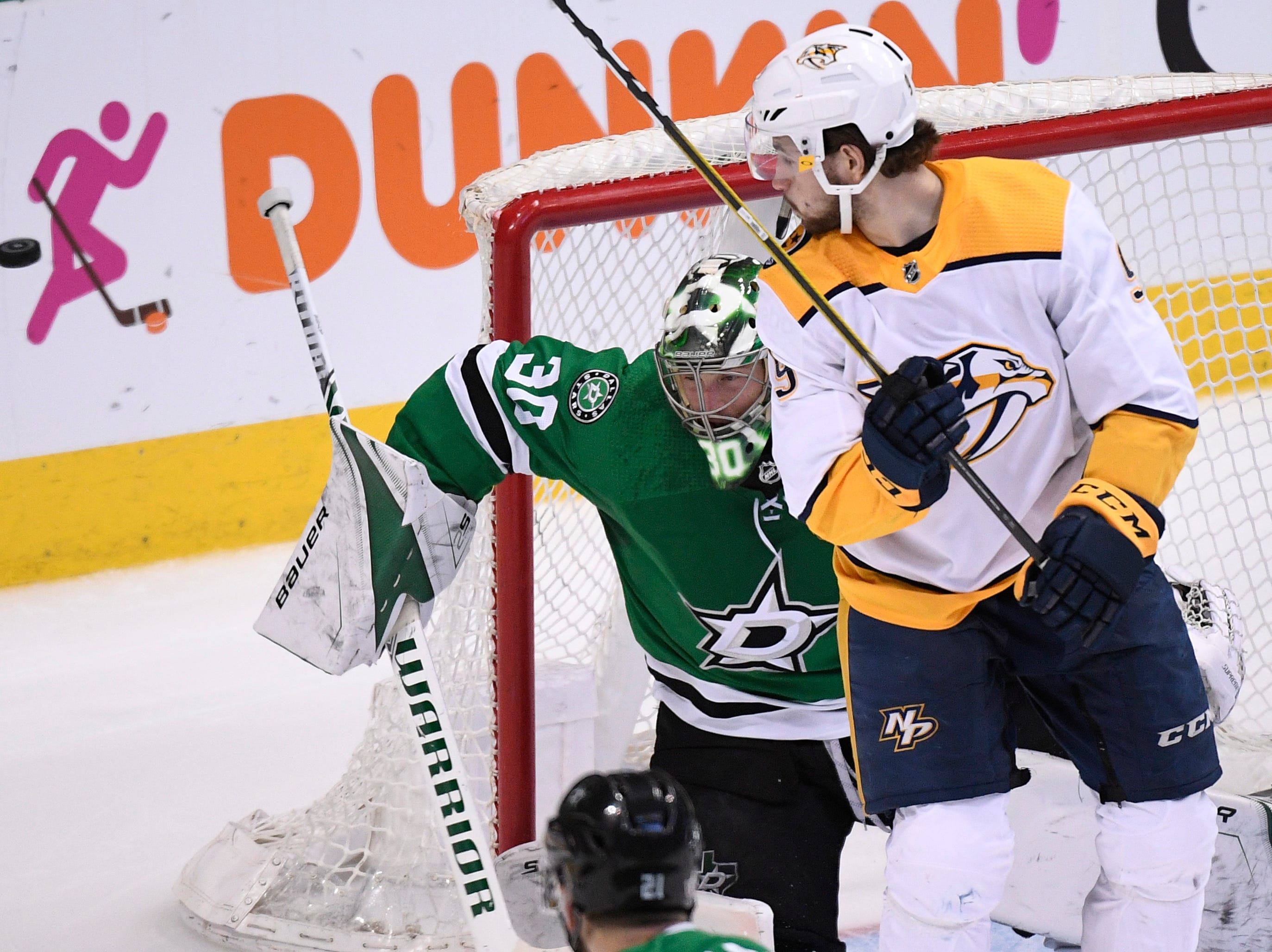 Dallas Stars goaltender Ben Bishop (30) defends the net against Nashville Predators left wing Filip Forsberg (9) during the second period of the divisional semifinal game at the American Airlines Center in Dallas, Texas, Monday, April 22, 2019.