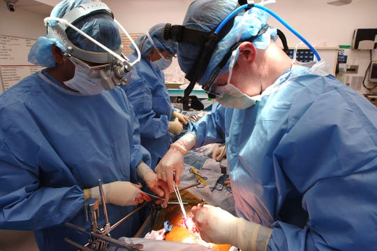Dr. Ravi Chari and Dr. Eric Grigan perform liver surgery at Vanderbilt University Medical Center in an undated photo. The hospital is one of 14 that has sued the federal government to halt implementation of a new policy on liver transplants.