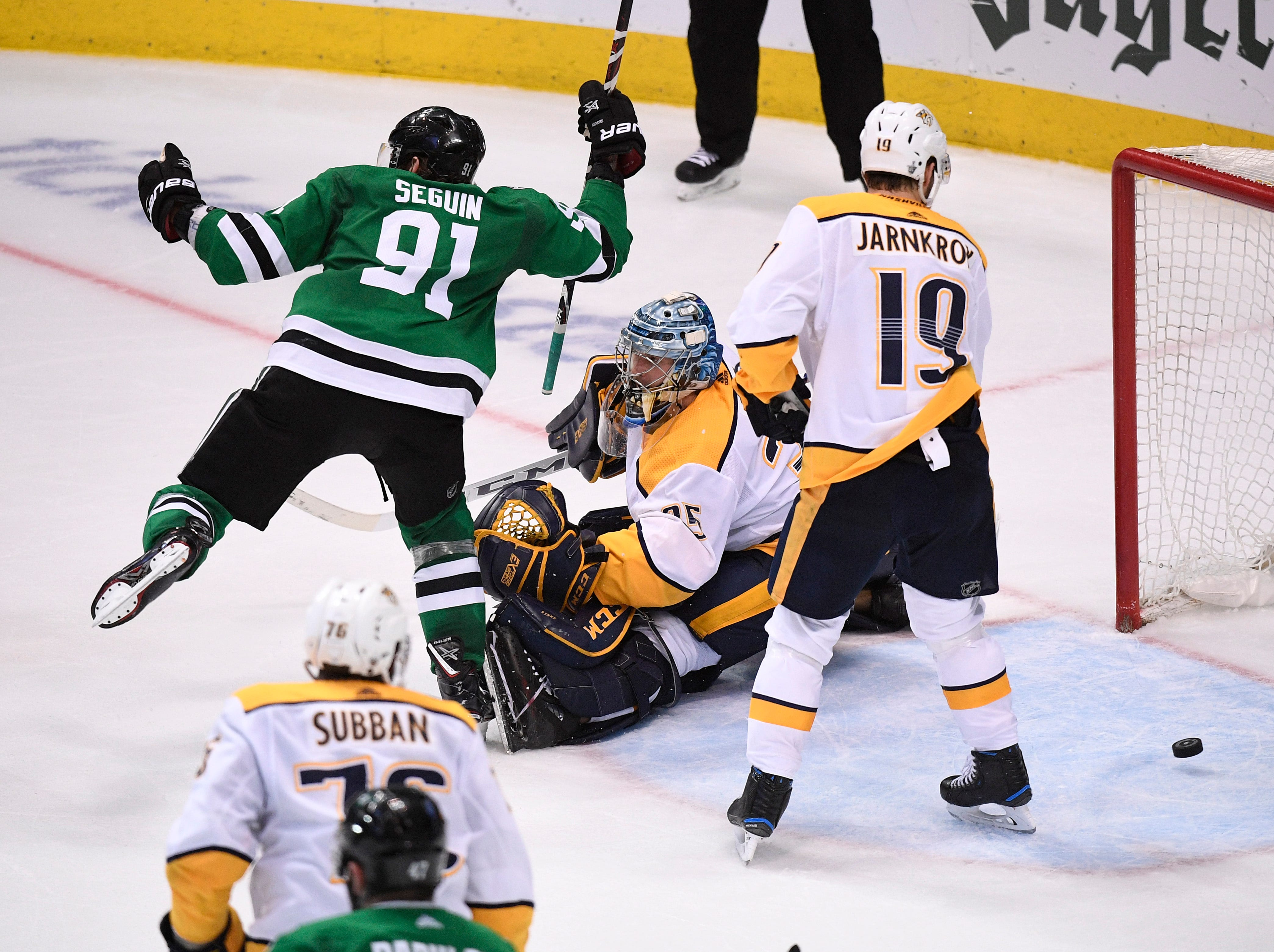 The puck bounces out of the net behind Nashville Predators goaltender Pekka Rinne (35) after the game-winning overtime goal by Dallas Stars defenseman John Klingberg (3) ending the divisional semifinal series at the American Airlines Center in Dallas, Texas, Monday, April 22, 2019.