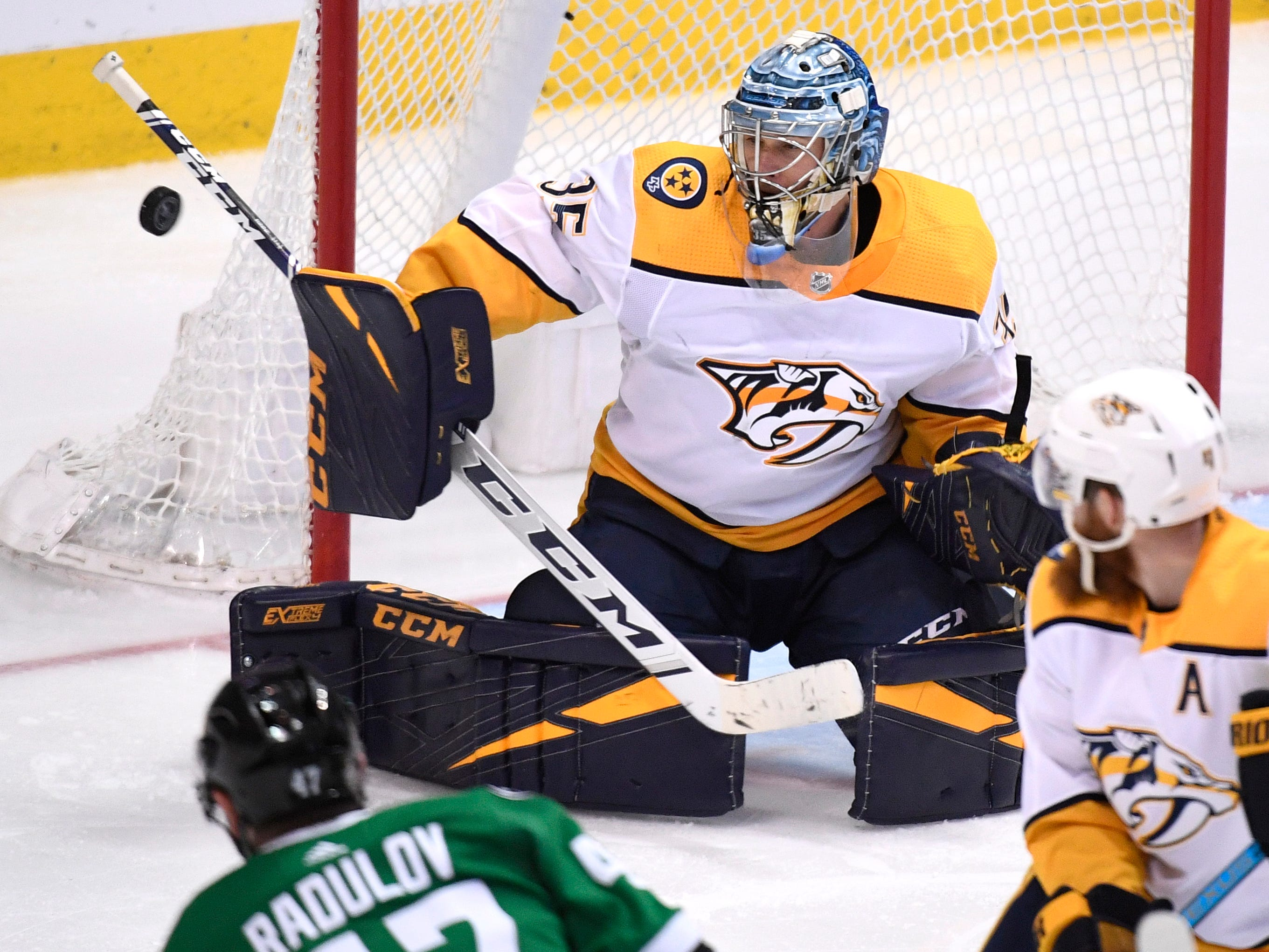 Nashville Predators goaltender Pekka Rinne (35) defends the net as Dallas Stars right wing Alexander Radulov (47) and Nashville Predators defenseman Ryan Ellis (4) watch during the third period of the divisional semifinal game at the American Airlines Center in Dallas, Texas, Monday, April 22, 2019.
