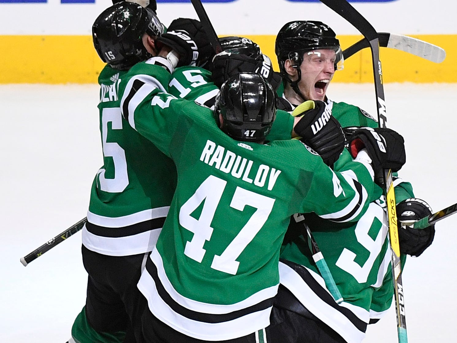 The Stars celebrate the game-winning overtime goal by Dallas Stars defenseman John Klingberg (3) ending the divisional semifinal series at the American Airlines Center in Dallas, Texas, Monday, April 22, 2019.