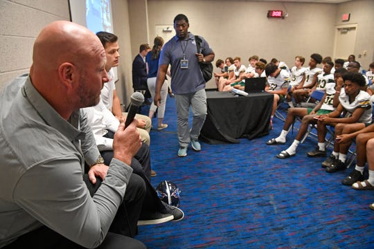 Trent Dilfer. former NFL quarterback and current Lipscomb Academy football coach talks with student athletes as the NFL and Tennessee Titans hosted 260 high school athletes at Play Football High School Day at Nissan Stadium dow}, April 23, 2019, in Nashville, Tenn.