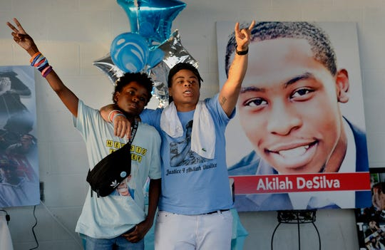 Aldane Dasilva celebrates the life of his brother, Akilah Dasilva, with his friend Latreece Booker, right, during a candlelight vigil at the Southeast Community Center on Monday, April 22, 2019, in Nashville, Tenn. Dozens of family, friends and community residents attended the event to commemorate the one-year anniversary of the mass shooting at a Waffle House in Nashville. Akilah was killed in the shooting along with three other victims.
