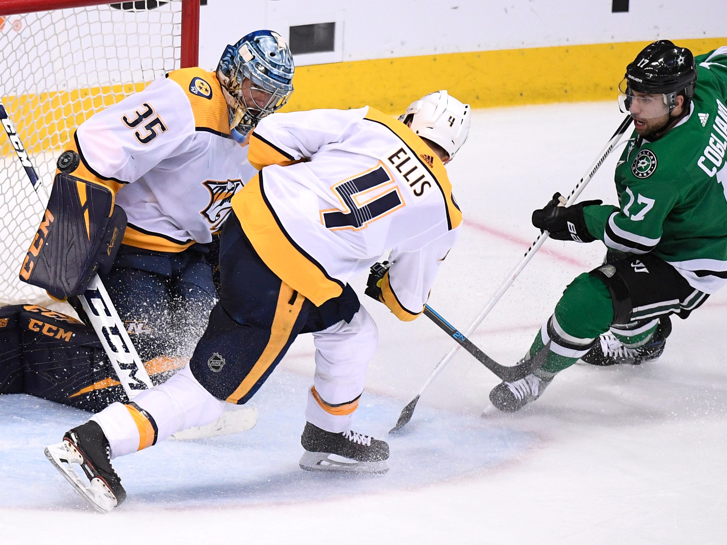 The shot by Dallas Stars center Andrew Cogliano (17) comes up wide of the net defended by Nashville Predators goaltender Pekka Rinne (35) and defenseman Ryan Ellis (4) during the third period of the divisional semifinal game at the American Airlines Center in Dallas, Texas, Monday, April 22, 2019.